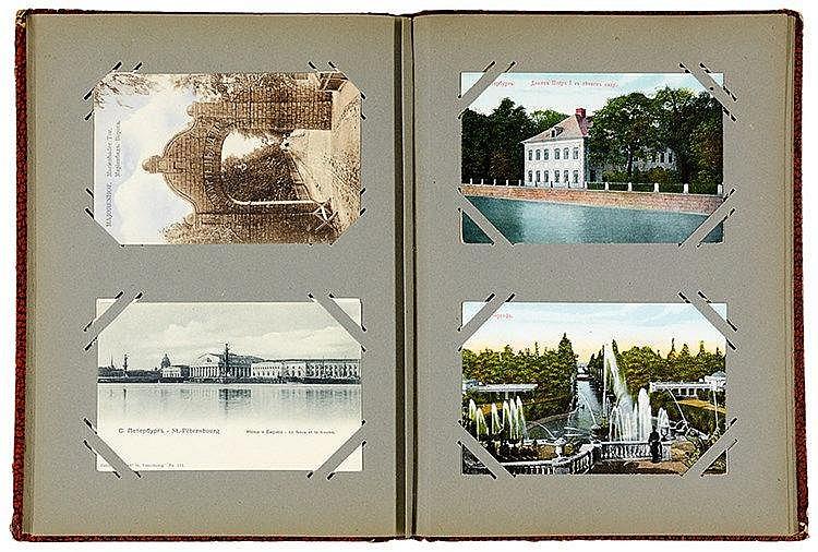 Russland - - Album mit 100 gesteckten, teils farbigen Postkarten aus Russla