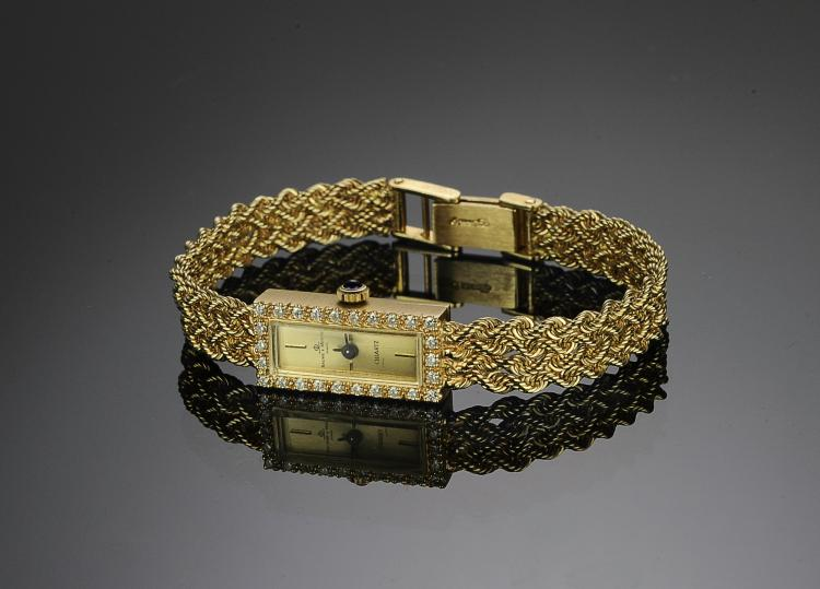 A 14K GOLD BAUME & MERCIER WATCH - DIAMOND BEZEL