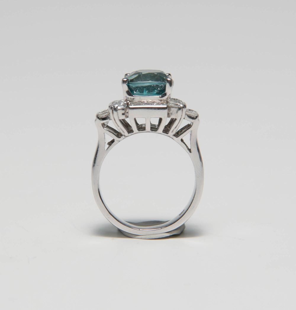 18K WG, 2.2 CTW DIAMOND AND NATURAL BLUE ZIRCON RING