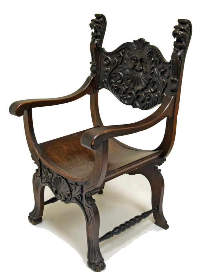 Carved oak north wind savonarola chair