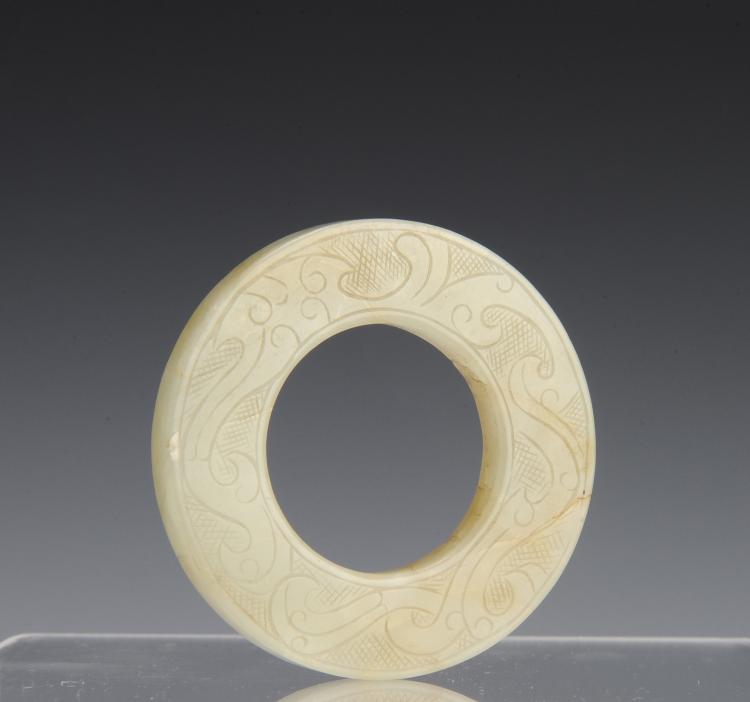 A Carved Jade Ring, Ming Dynasty or Earlier