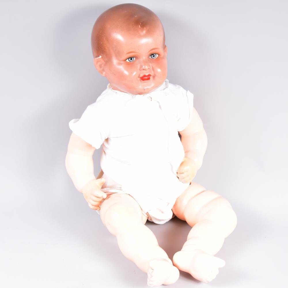 Babypuppe, L 60cm, um 1945, für Demonstrationszwecke in der Kinderpflege, Masse-Einbindekopf ungemarkt, Stoffkörper, ein Bein lose, sonst guter Zustand