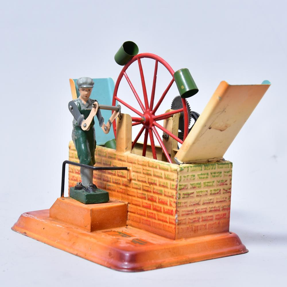 Antriebsmodell f. Dampfmaschine, Fa. Fleischmann, um 1930/40, Blech lithogr., Wassermühle m. Figur, Maß: 14x10x13,5cm