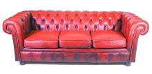 A Pair of Vintage Red Leather Buttoned Back Three Seater Chesterfield Sofas