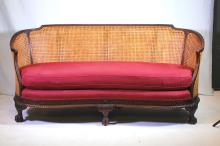 A French Walnut, Cained, and Upholstered Settee, C1900
