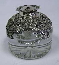 A Victorian Silver-Mounted Clear Glass Ink Well Bottle, William Comyns & Sons, London, 1899