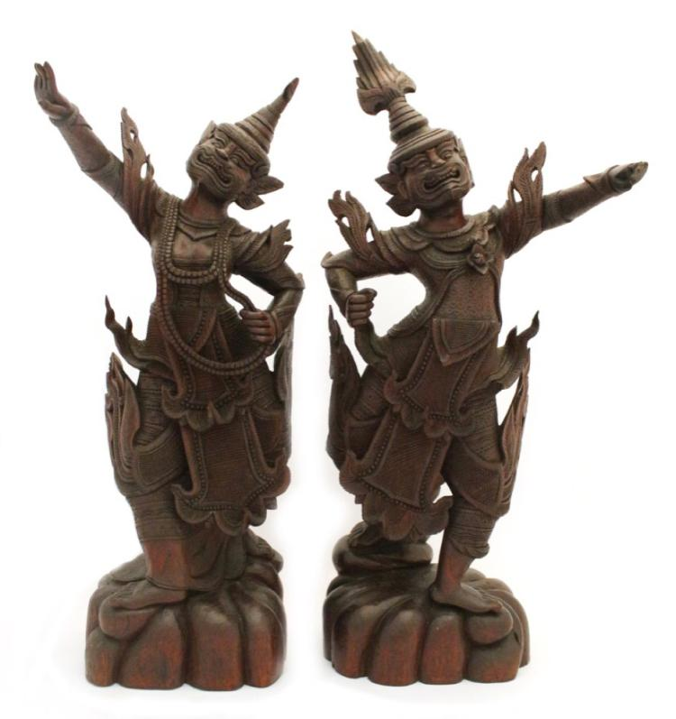 A Pair of Balinese Carved and Stained Rosewood Figures of Dancers