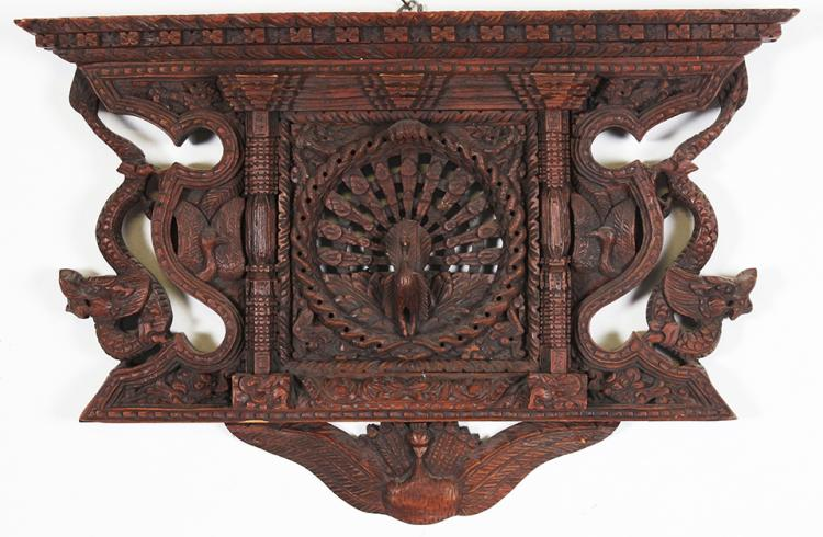 A Balinese Pierced and Carved Wooden Panel