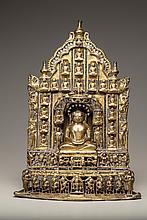 A gilt bronze Jain Tirthankara with silver inlay
