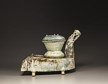 A green-glazed pottery stove with a dragon chimney