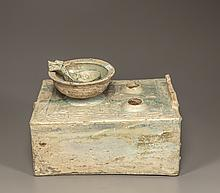A green-glazed pottery cooking stove, bowl, and ladle