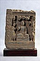 A GANDHARAN SCHIST RELIEF OF SEATED BUDDHA WITH ATTENDANTS UNDER BODHI TREE