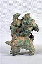 A VERY EARLY HINDU BRONZE SCULPTURE OF MOTHER HOLDING CHILD