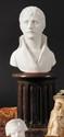 S.L. BOIZOT (1743-1809), D'APRES. ECOLE FRANÇAISE. « Le Premier Consul Bonaparte. » Biscuit de Niderviller en buste. Monté sur une colonne ronde cannelée avec cartouche « Niederviller ». Ht : 33 cm. On y joint une médaille ronde de la Manufacture de