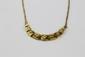 COLLIER en or jaune orné de diamants de taille brillant. Poids brut : 16,4 g