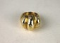 BAGUE en or jaune bombée et  réhaussée de trois lignes de diamants taille brillant en serti étoilé. Poids brut: 18,1 g. TDD: 50,5