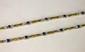 LOT DE DEUX BRACELETS composés d'une succession de motifs en or jaune alternés de motifs en or gris sertis de de diamants taille brillant et d'un cabochon oval de saphir pour le premier  et rubis pour le second. Poids brut: 27,5 g. Longueur: 19 cm.