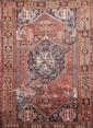 QUASGAÏ (Iran) sur fond brique à large médaillon central géométrique encadré par des colonnettes à chevaux, 4 écoinçons bleu nuit Vers 1940/50 265 x 162 cm