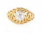 BAGUE en or jaune ornée d'un diamant serti clos de 1 carat envion. la monture finement ciselée stylisant du feuillage. Poids brut : 9,1 g TDD : 54  A diamond and yellow gold ring