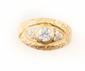 BAGUE en or jaune ornée d'un diamant de taille ancienne la monture ciselé, la pierre de centre en serti clos. Poids brut : 10,8 g TDD : 61  A diamond and yellow gold ring