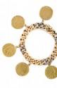 GOURMETTE en or jaune, ponctuée de diamants taillés en rose, retenant six pièces en or jaune. Poids brut : 82 g  A diamond and yellow gold bracelet