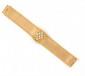 BRACELET MANCHETTE en or jaune à maille ruban la bordure en chainette, système de montre sertie de diamants de taille brillant. Poids brut : 54,1 g  A diamond and yellow gold bracelet