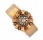 BRACELET manchette en or jaune et émail noir, orné d'un motif surmonté d'un diamant de taille rose de taille ancienne dans un entourage de perles fines. Travail du XIX° siècle. Poids brut : 31,5 g A diamond, pearl, black emaul and yellow gold
