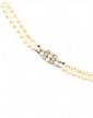 COLLIER orné de deux rangees de perles, le fermoir ponctué de perles dans un entourage de brillants Poids brut : 33,7 g  A peal, diamond necklace
