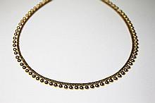 COLLIER en or jaune, stylisant une succession de perles en or jaune. Poids brut : 18,5