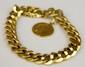 GOURMETTE en or jaune ornée d'une médaille. Poids brut : 56 g