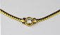 COLLIER en or jaune, maille figaro, retenant en son centre un diamant en serti clos d'environ 2 carats.