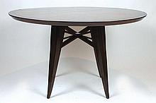 MAXIME OLD (1910-1991)  Rare table ronde en palissandre et placage de palissandre.