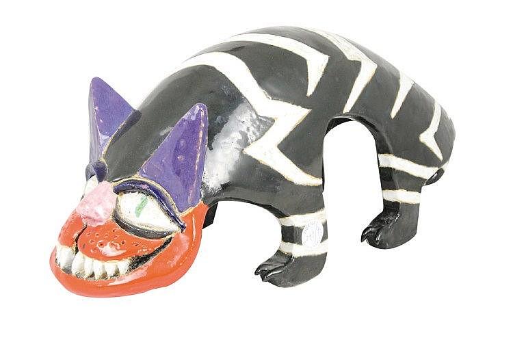 Jacky COVILLE (né en 1936) Chat zébré noir et blanc Céramique Signée 25 x 56 x 20 cm