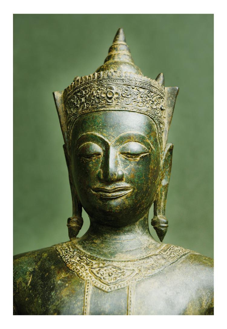 Thaïlande 16ème siècle. Statuette de bouddha debout en bronze à patine brune, la coiffe ornée d'une tiare. H. 95,5 cm.