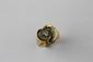 BAGUE en or jaune stylisant une volute en enroulement retenant en son centre un diamant de taille brillant. Poids brut : 8,6 g TDD : 55