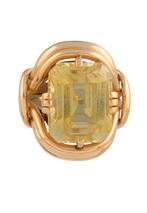 MELLERIO BAGUE en or jaune ornée d'une importante citrine de taille émeraude, la monture finement ajourée et torsadée. Poids brut : 28,5 g La monture Numérotée et signée par la maison