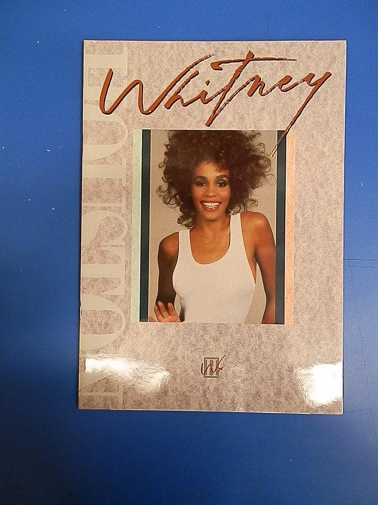 Whitney Houston 3 page glossy coloured biography.