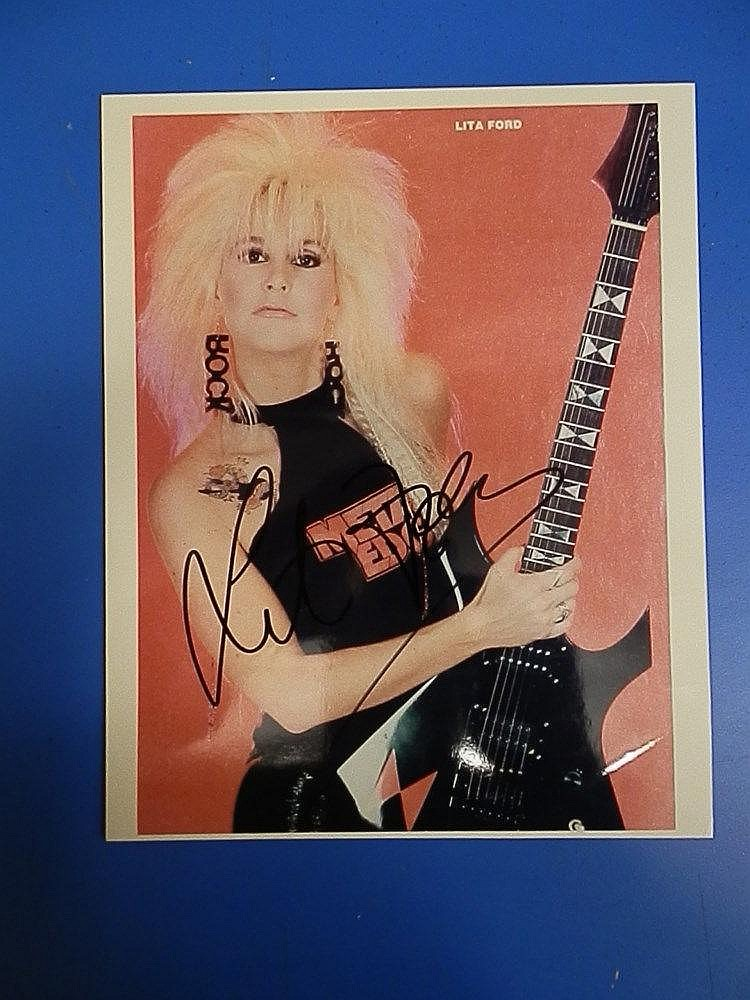 Lita Ford signed coloured photograph.