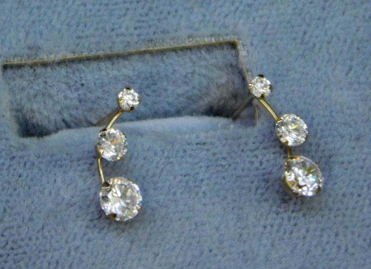 Lot 6: 10 Karat Gold Suspended Cz Tri Stone Earrings In