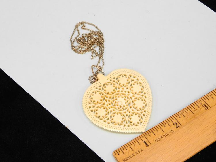 Lot 149: Antique Huge Carved Ivory Incised Flower Heart