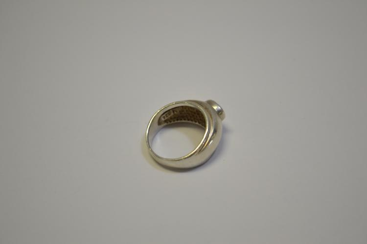 Lot 167: Modern Sterling Silver And Encased Cz Ring