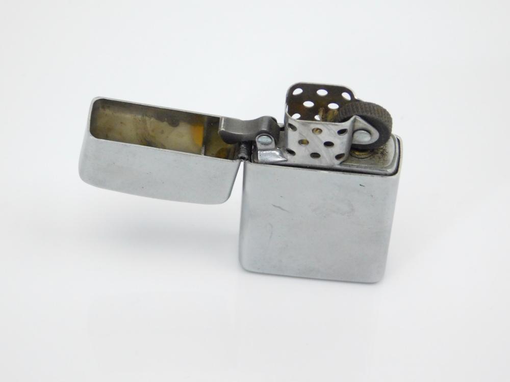 Lot 77: 2009 Zippo Slim Refillable Lighter