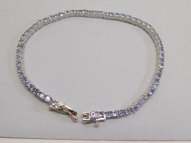 Sterling Silver And Tanzanite Tennis Bracelet.