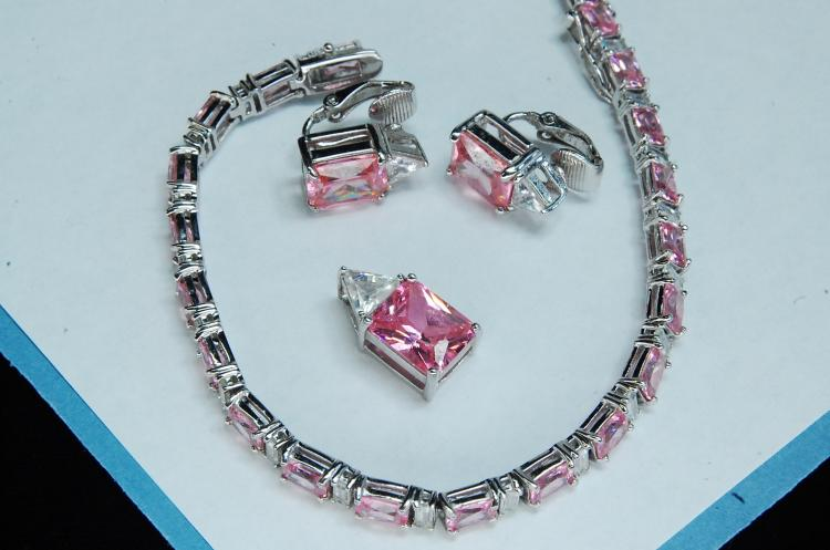 Lot 18: Costume Pink CZ Bracelet Earrings Pendant Set