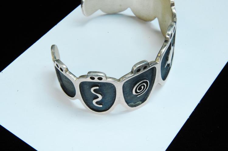 Lot 150: Vintage 30g Sterling Hopi Symbol Cuff Bracelet