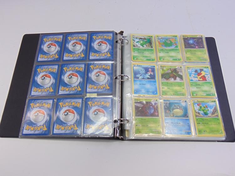 Lot of 126 Collectible Pokemon Cards in Protective Pages