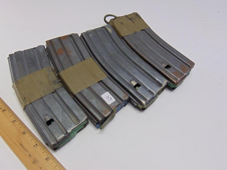 Lot 64: Lot of 4 Center Industries and Brownells US Military .223 5.56 Rifle 10 Round Magazine Clips
