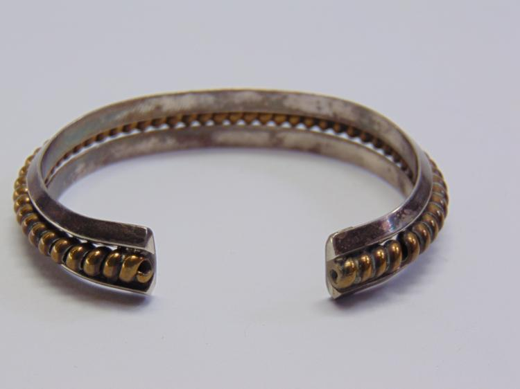 Lot 159: Sterling Silver and Brass 35.3 Gram Navajo Cuff Bracelet