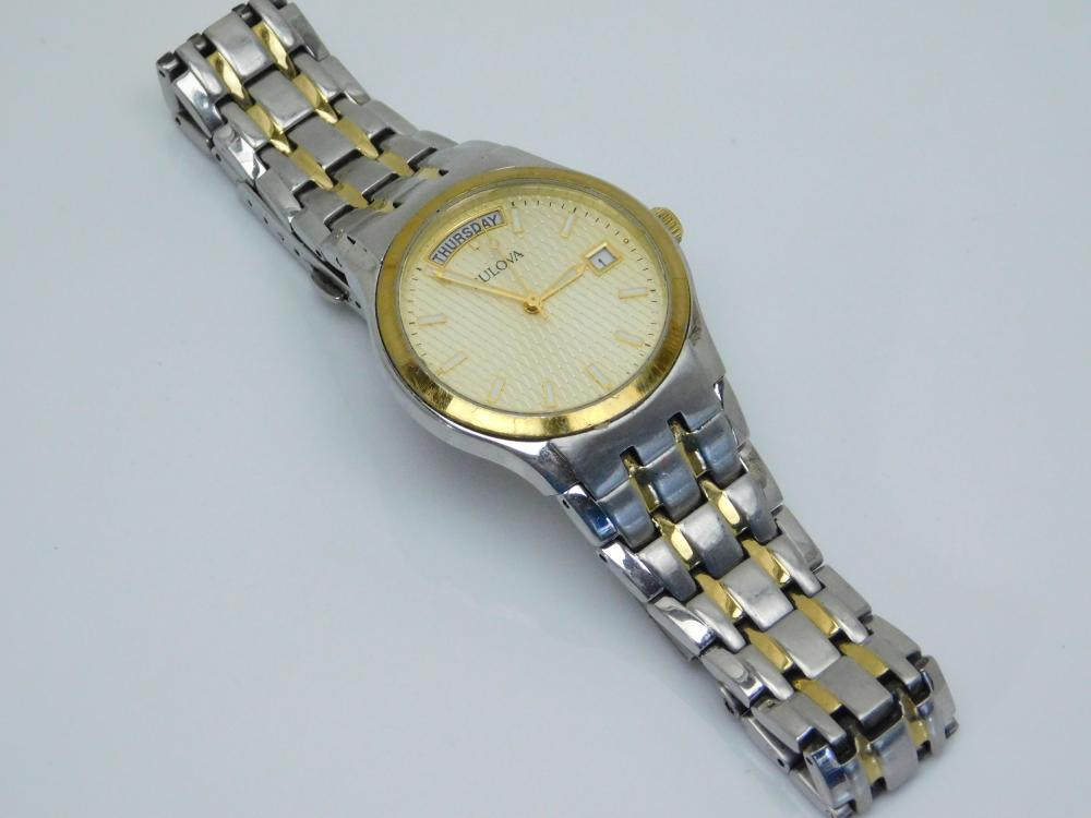 Mens Bulova Goldtone Accents Stainless Steel Day Date Wristwatch