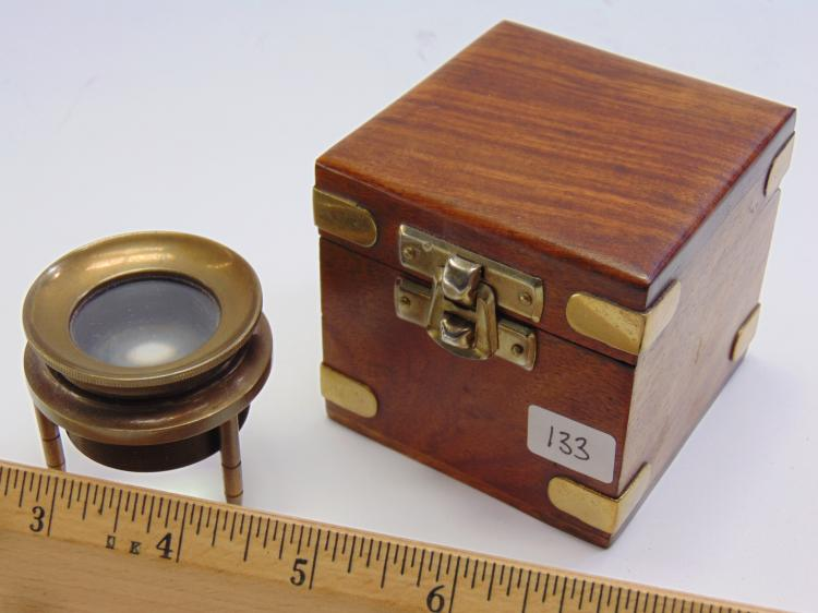 Lot 133: Vintage Brass Map Magnifying Glass in Wood Case